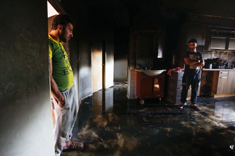 """""""כשאנשי חוק מנצלים את הכוח שבידיהם לרעה, הם צריכים לעמוד לדין"""". הבית שהוצת בדומא צילום: Haytham Shtayeh, פלאש 90"""